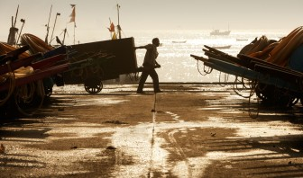 Human power operates the Sassoon Docks. Fish and supplies are ferried by hand carts.
