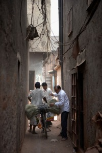 An alleyway in the Dharavi Slum in Mumbai where an estimated 300,000 to one million people live. This so-called informal economy creates millions of dollars in goods much of it will be center to the U.S. and Europe.