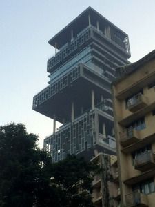 This 27 story building is Mumbai's most controversial home. It was built by India's richest man, Mukesh Ambani, and it cost more than $2 Billion. It looks down upon millions of Indians who live in slums.