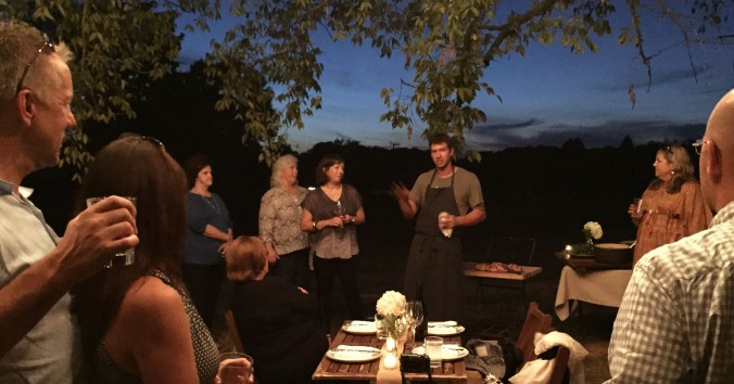 Chef Dustin Busby, formerly of Blackberry Farm, now manager of the Century Harvest Farms kitchen, explains the evening menu. Located in Greenback, Tennessee, the farm owned by Christopher and Shona Burger, specializes in 100% grass-fed beef, pastured pork, chicken and eggs and seasonal vegetables and uses organic and sustainable farming practices. The Burgers alternate crops, cultivate legumes and use the fertilizer produced naturally by the farm's animals.