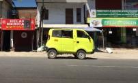 A Tata (really) mini van parked on the street in Kumali.