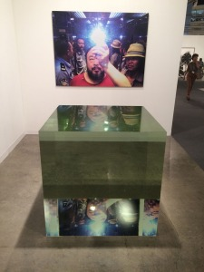 The top is a selfie by Ai Weiwei taken when he was arrested by police in Beijing, it reflects through a perfect acrylic cube.