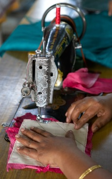 Sewing is just one way that Families For Children creates income. On the top floor of a three-story walk up building on the grounds is the Women's Co-op. The whirring of fans competes with the whirring of the pedal-powered sewing machines.