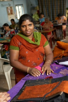 Mano, 32, is the Women's Co-op manager, overseeing seven seamstresses. She arrived at 14-years-old after her mother had committed suicide unable to continue with an abusive husband. She and her brother were placed on a farm as bonded laborers to pay off the father's debts. FFC found Mano and her brother through a hospital. FFC helped her find her talent in a batik and bag making course.