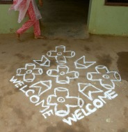 Each morning a fresh Welcome is drawn in chalk at the door to the Families For Children office.