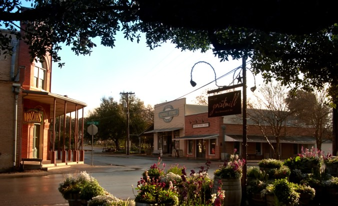 Early morning on Gruene's main corner. The merchantile building is to the left and the Gristmill is the former Cotton Gin now a restaurant with 11 distinct dining areas.