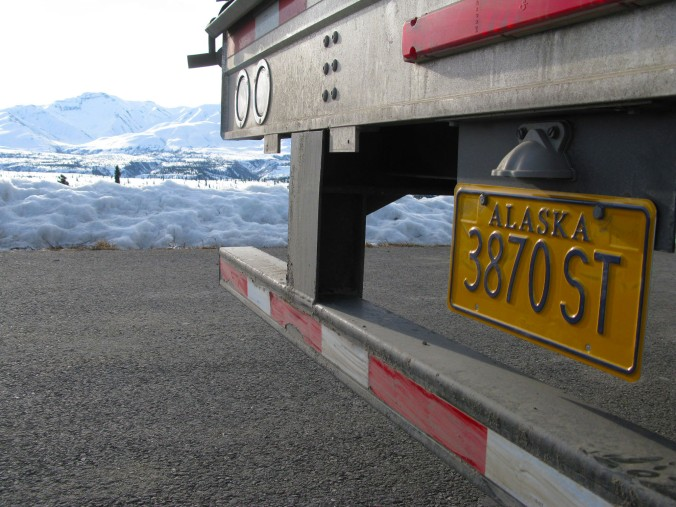 My prized trucking souvenir, the Alaska license plate. Now, I'm really an industry veteran, qualified to tell tall trucking tales.