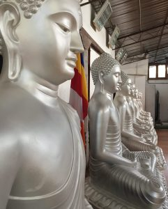 The second level of the Gangaramaya Buddhist Temple is ringed with buddha statues.